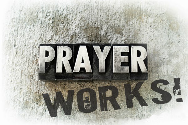 Prayer Works words on white stone background  with blogsite